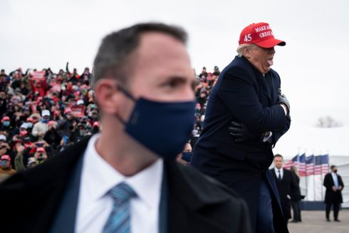 DOWN TO THE WIRE: US president Donald Trump makes a mock reaction to the cold during a re-election rally at Total Sports Park in Washington, Michigan, US. Photograph: Brendan Smialowski/AFP/Getty
