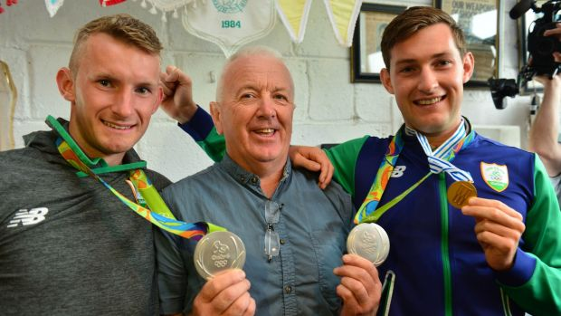 Skibbereen coach Dominic Casey pictured with Olympic silver medallists Gary and Paul O'Donovan. Photograph: Michael Mac Sweeney/Provision