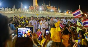 Thailand's King Maha Vajiralongkorn and Queen Suthida greet royalist supporters outside the Grand Palace in Bangkok. Photograph:  Lillian Suwanrumpha/AFP) via Getty Images