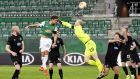 Maximilian Hofmann of Rapid Vienna beats Dundalk goalkpper Aaron McCarey to the ball to score his side's third goal during the Uefa Europa League Group B match. Photograph: Christian Bruna/EPA