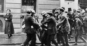 1920: A casualty is carried away during the Irish War of Independence when Sean Treacy of the Irish Volunteers' South Tipperary Brigade shot and killed two RIC constables at Talbot Street in Dublin. Photograph:  Sean Sexton/Getty Images