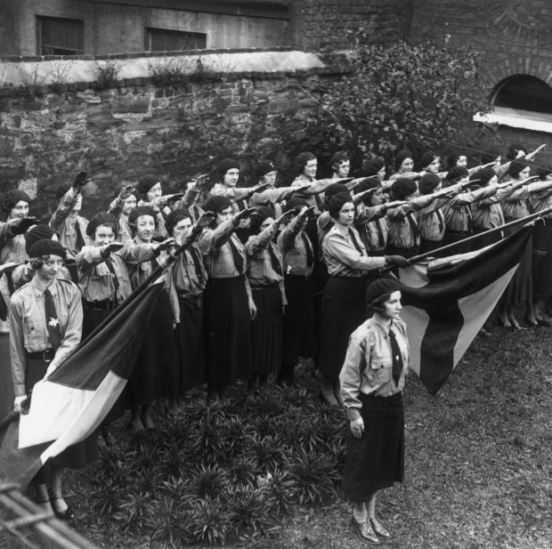 Blueshirts: members of the United Ireland Party give a fascist salute during a parade at their headquarters, on Merrion Square in Dublin. Photograph: Keystone/Getty