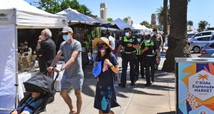 Officers patrol Melbourne's St Kilda esplanade markets on November 8th, as Victoria's state government announces an easing of restrictions with no new cases of Covid-19 for ninth day in a row. Photograph: William West/AFP via Getty