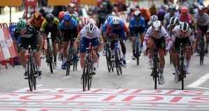 Bora-Hansgrohe's German rider Pascal Ackermann (L) speeds to the finish-line of the 18th and final stage of the 2020 La Vuelta cycling tour of Spain. Photograph:  Oscar Del Pozo/ AFP  via Getty