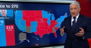 CNN news anchor John King has been one of the media stars of the US election coverage thanks to his 'magic wall' interactive election map. Photograph: CNN.