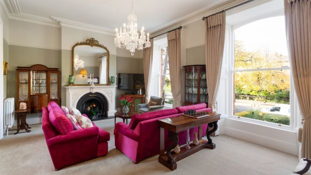 At hall level, the drawing room overlooks the old trees to the front through two tall sash windows at 43 Palmerston Road.