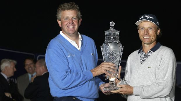 Colin Montgomerie and Bernhard Langer with the trophy after both shared the Volvo Masters at Valderrama in November 2002. Photograph: Andrew Redington/Getty Images