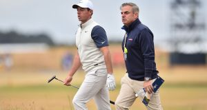 Rory McIlroy  with former Ryder Cup captain Paul McGinley. Photograph: Glyn Kirk/AFP/Getty