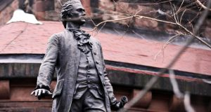 A statue of Alexander Hamilton on the grounds of St Luke's Episcopal Church in New York.  Photograph: Byron Smith/The New York Times