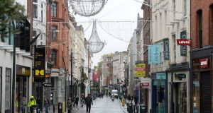 Christmas lights on Grafton Street, Dublin, but most shops are closed. Photograph: Dara MacDónaill/The Irish Times