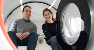 Strap in: Josh Giegel and Sara Luchian, Virgin Hyperloop executives, become the first passengers to travel on the futuristic high-speed ground transport. Photograph: Virgin Hyperloop/PA