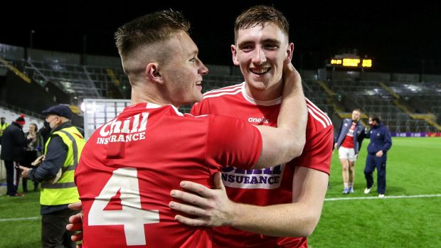 Cork's Kevin Flahive celebrates with Mark Keane after victory over Kerry at Páirc uí Chaoímh. Photograph: ©INPHO/Laszlo Geczo