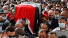 Palestinian mourners and honour guard carry the coffin of late Palestinian chief negotiator Saeb Erekat during his funeral procession in the West Bank city of Jericho on Wednesday. Photograph: Ahmad Gharabli/  PPO / AFP via Getty Images