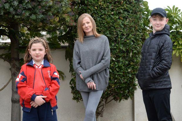 Tara Dalton, with her children Daniel and Ella Rose at home in Monkstown, Dublin. Photograph: Dara Mac Dónaill