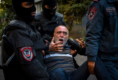 RALLY: Armenian police officers detain a protestor during a rally against the country's agreement to end fighting with Azerbaijan over the disputed Nagorno-Karabakh region in Yerevan on November 12th. Armenia arrested 10 leading opposition figures for violently protesting against a Russian-brokered peace deal that ended weeks of fighting with Azerbaijan and sparked fury with prime minister Nikol Pashinyan. Photograph: Karen Minasyan/AFP via Getty