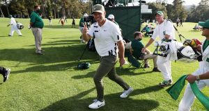 Paul Casey of England gives a thumbs up as he walks off a green during the first round of the Masters at Augusta National Golf Club. Photo: Rob Carr/Getty Images