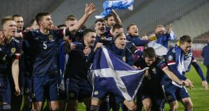 Scotland's players celebrate after winning the penalty shootout   in Belgrade. Photo: EPA