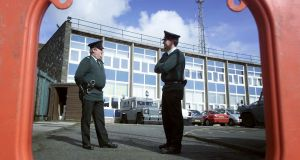 Police officers standing guard outside Castlereagh police station in east Belfast in 2002. Photograph: Paul McErlane/Reuters
