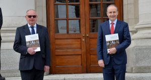 Tim Ryan, editor of The Irish Times Nealon's Guide, presenting a copy to Taoiseach Micheál Martin at Government Buildings on Friday. Photograph: Alan Betson/The Irish Times