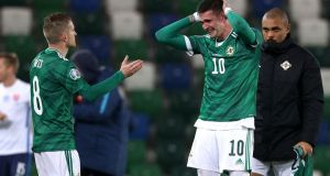 Northern Ireland's Steven Davis  and Kyle Lafferty react after losing to Slovakia in the Euro 2020 Play-off finals. Photograph:   Liam McBurney/PA Wire