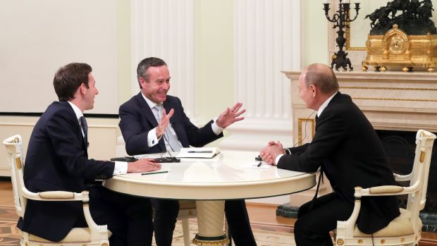 Vladimir Putin gives an interview to Financial Times editor Lionel Barber and the paper's Moscow bureau chief Henry Foy. Photograph: Mikhail Klimentyev