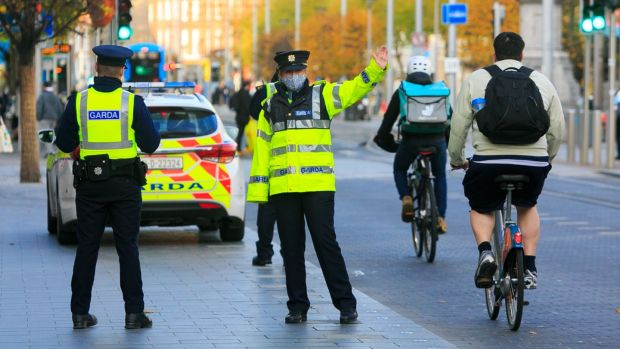 Gardaí operating a Covid-19 restrictions checkpoint on O'Connell Street, Dublin, this weekend. Photograph: Gareth Chaney/Collins
