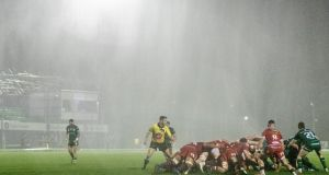 Connacht and Scarlets contest a scrum in the heavy rain during their Pro14 clash. Photo: James Crombie/Inpho