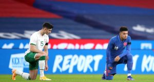 Republic of Ireland football player Callum O'Dowda and England's Jadon Sancho take a knee in support of the Black Lives Matter movement before their international friendly at Wembley Stadium, London last Friday. Photograph: Nick Potts/PA Wire