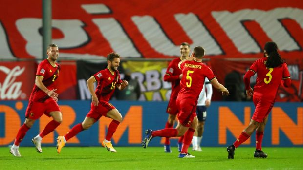 Dries Mertens celebrates after scoring Belgium's second goal against England. Photograph: Dean Mouhtaropoulos/Getty