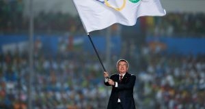 IOC president Thomas Bach waves the Olympic flag during the closing ceremony of  the  2014 Summer Youth Olympic Games at the Nanjing Olympic Sports Centre  in China. Photograph: Lintao Zhang/Getty Images