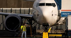 A worker beside a Boeing 737 Max aircraft parked at the company's Renton production facility in Washington. Photograph: David Ryder/Getty Images