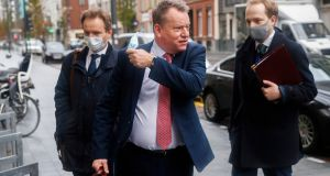 Monday motivation: Britain's chief negotiator David Frost (centre) removes his face mask to talk to the media as he arrives for Brexit talks in Brussels. Photograph: Francisco Seco/AP