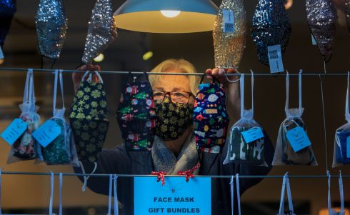 COVER OPTIONS: Margaret Costelloe of Costelloe + Costelloe arranges festive Christmas masks at her store in Dublin's city centre. Photograph: Gareth Chaney/Collins
