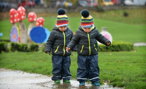 MATCH DAY: Two-year-old twins Tal and Micah are pictured in Merrion Square, Dublin. Photograph: Dara Mac Dónaill/The Irish Times