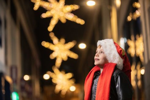 CHRISTMAS LIGHTS: Aidan Russell watches as Cork city lights up for Christmas, kickstarting the city's seasonal celebrations. Photograph: Darragh Kane