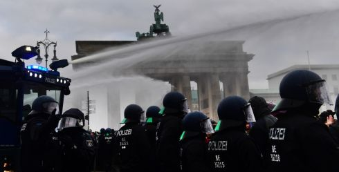COVID PROTEST: Riot police use a water cannon to break up a demonstration against German coronavirus restrictions in front of the Brandenburg Gate in Berlin. Photograph: Filip Singer/EPA
