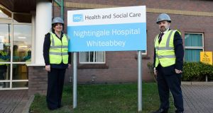 Northern Ireland Minister or Health Robin Swann with chief nursing officer Charlotte McArdle at the opening of a Nightingale hospital in Whiteabbey, Belfast. Photograph: Michael Cooper/PA Wire