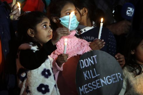 Pakistani journalists and their families hold candles to mark International Day to End Impunity for Crimes Against Journalists, in Islamabad, Pakistan. Photograph: Sohail Shahzad/EPA