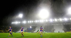 Tipperary's John McGrath, Ronan Maher and Alan Flynn leave the Páirc Uí Chaoimh pitch after the defeat to Limerick in the Munster SHC Final. Photograph: Ryan Byrne/Inpho