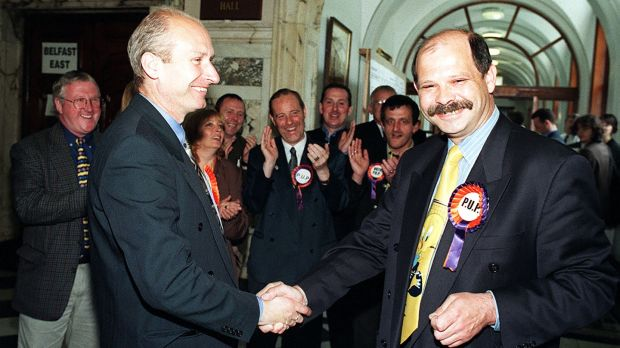 Progressive Unionist party leaders Billy Hutchinson and David Ervine celebrate with their supporters in Belfast city hall in 1998. Photograph: Paul Faith/Pacemaker