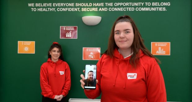Caitlin Somers, right, with mentor Paul Keegan via video call  and  youth work team leader Erin Ballesty, left, at YMCA  Aungier Street. Photograph: Alan Betson