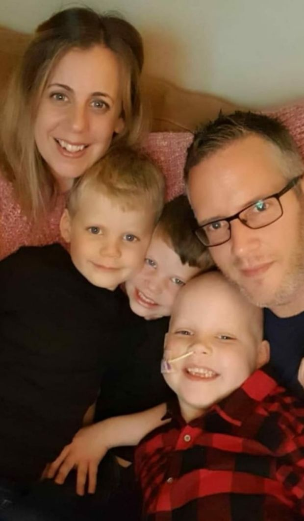 Selling up: Lucy and Mark Keoghan with their children, including Mollie, their seven-year-old daughter, who has leukaemia