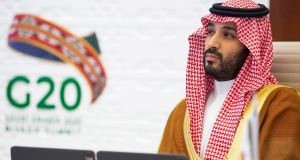 Saudi Crown Prince Mohammed bin Salman attending the virtual G20 summit, which his country is hosting. Photograph: Bandar Al-Jaloud/Saudi Royal Palace/AFP via Getty Images.