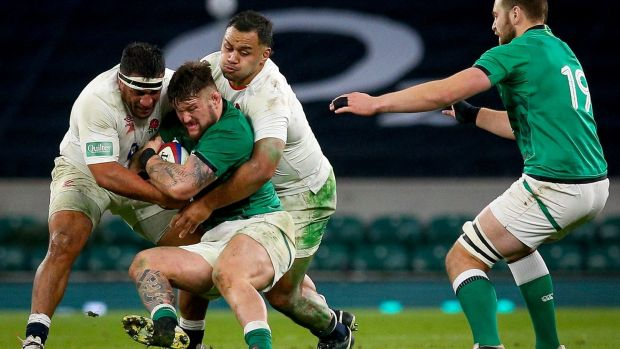 Ireland's Andrew Porter is tackled by Mako Vunipola and Billy Vunipola of England. Photograph: Craig Mercer/Inpho