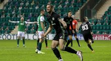 Celtic's Shane Duffy celebrates his side's second goal scored by team-mate Diego Laxalt (background) during the Scottish Premiership match against Hibernian at Easter Road. Photograph: Andrew Milligan/PA Wire
