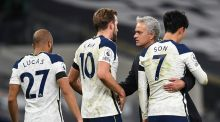 Tottenham manager Jose Mourinho   and his players react after beating Manchester City in London. Photograph:  Neil Hall/EPA