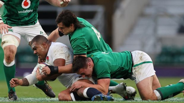 Kyle Sinckler is tackled by Ireland's Quinn Roux and Ronan Kelleher. Photograph: Billy Stickland/Inpho
