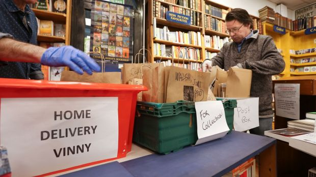 Vinny Byrne packing books for delivery at Charlie Byrne's Bookshop in Galway city. Photograph: Joe O'Shaughnessy