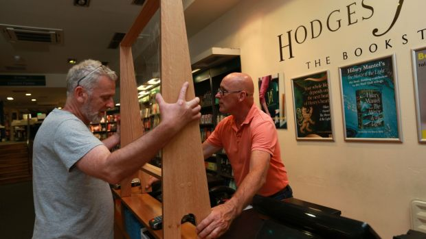 Liam Donnelly and Tony Hayes, managers at Hodges Figgis on Dawson Street in Dublin, put in social distancing measures ahead of their opening in Phase 2 of the lockdown easing. Photograph: Laura Hutton