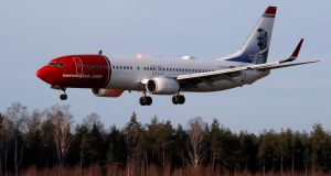 A Norwegian Air Boeing 737-800 landing at Riga International Airport in Latvia earlier this year. Aircraft manufacturer Boeing is bidding to stall the troubled airline's $1 billion lawsuit against it while the Scandinavian carrier lines up a rescue attempt in the Irish courts. Photograph: EPA/TOMS KALNINS